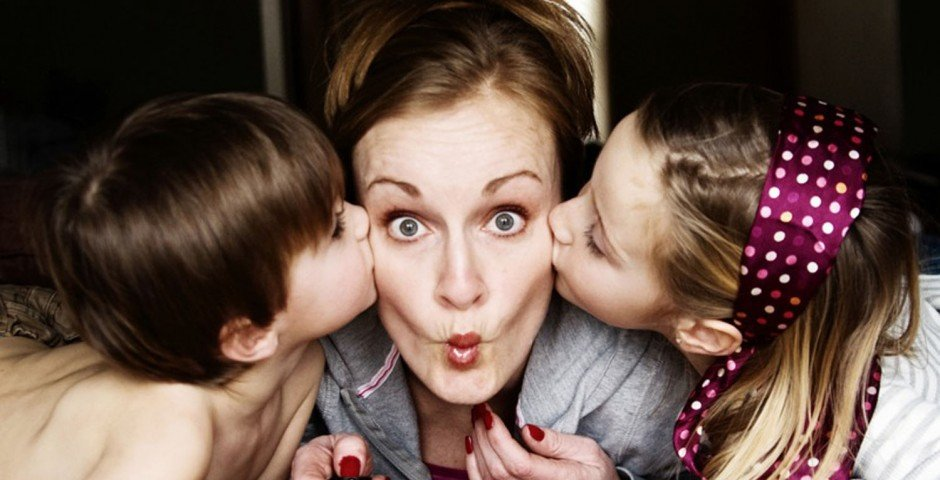 Mom with puckered lips being kissed by kids ~PhotograTree~ Photo URL    : http://www.flickr.com/photos/lightfalling/2261753548/