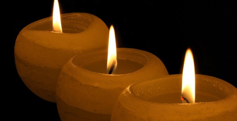 Three-yellow-candles-in-the-dark