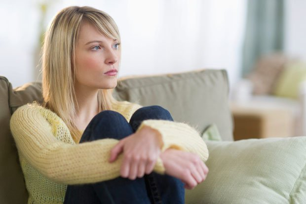Disappointed-woman-in-living-room-430357