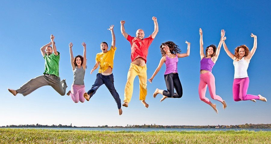Happy smiling  group of jumping  people